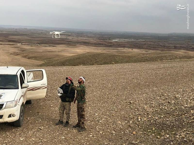 تلاش بسیج مردمی عراق برای حذف پرچم سفید ها